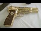 Chez l'armurier ! 1363180805-pistolets-jumeaux-a-vrilles-d-or
