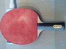 http://image.noelshack.com/minis/2013/03/1358613670-raquette-2-revers.png