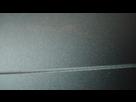 1572366927-capotgrosplanrayure.png